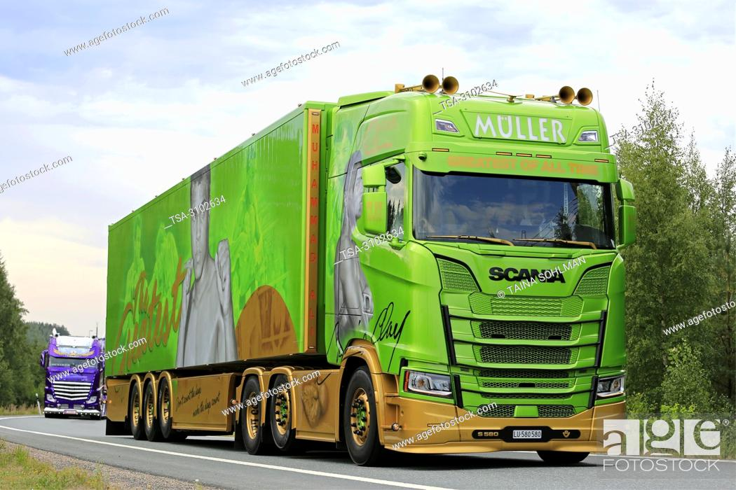 Stock Photo: LEMPAALA, FINLAND - AUGUST 9, 2018: Mohammad Ali themed Scania S580 semi trailer of Franz Muller Ermensee Ag in truck convoy to Power Truck Show 2018.