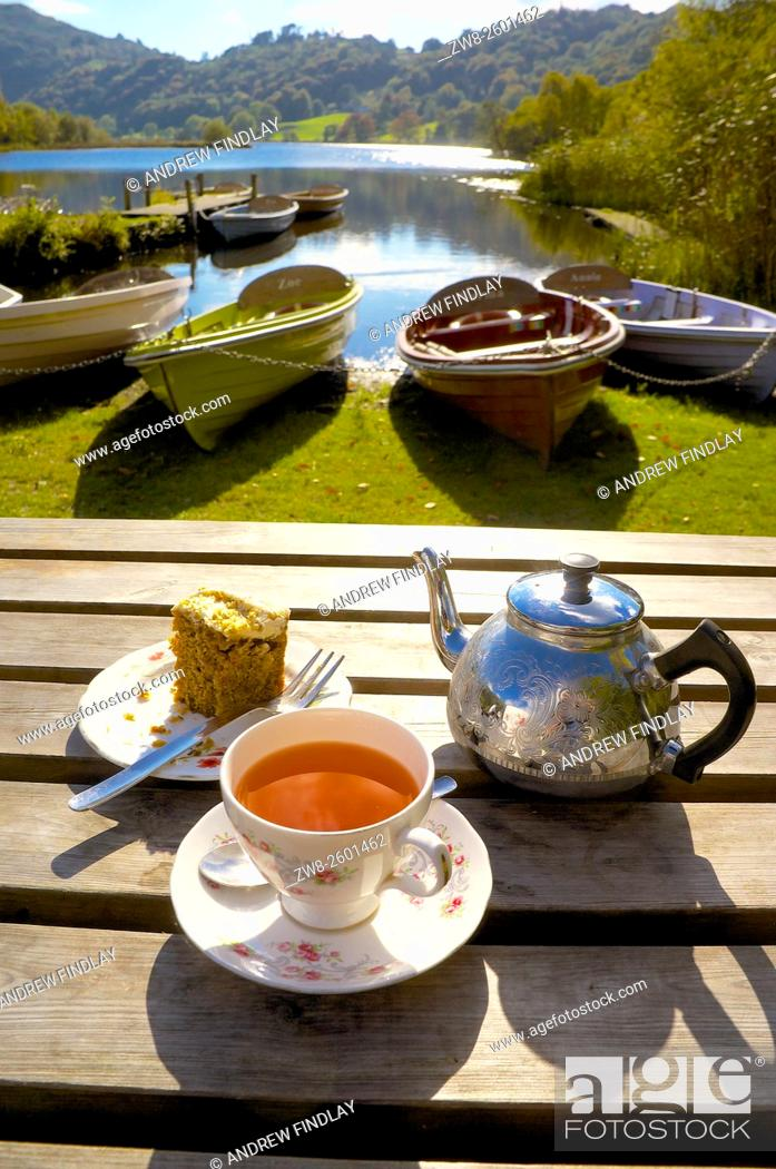 Stock Photo: The Lake District. Afternoon Tea in front of beached boats. Grasmere, Lake District National Park, Cumbria, England, United Kingdom.