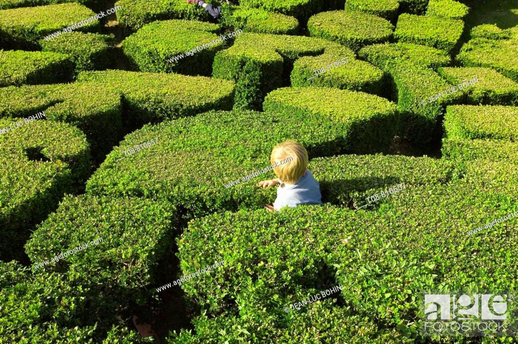 Stock Photo: France, Ile de France, park of Breteuil castle: child playing in the hedge.