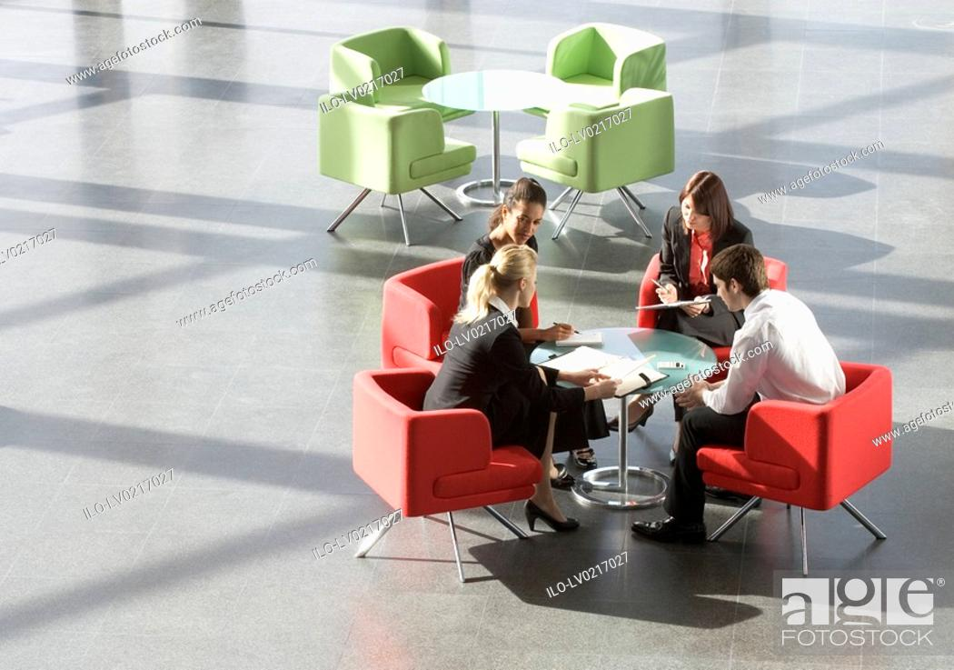 Stock Photo: Four business colleagues having a meeting in an office building.