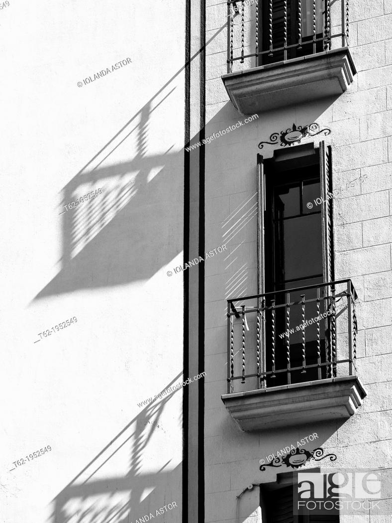 Stock Photo: Balconies and shadows of a manor house in the Gracia district of Barcelona.