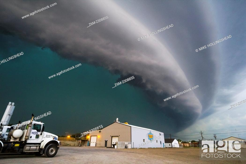 Stock Photo: Very fast moving and severe bow echo moves down the highway from Redfield to Watertown South Dakota. Forward speed of the bow was around 60mph.