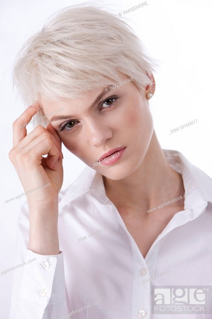 Stock Photo: Worried young woman touching head.
