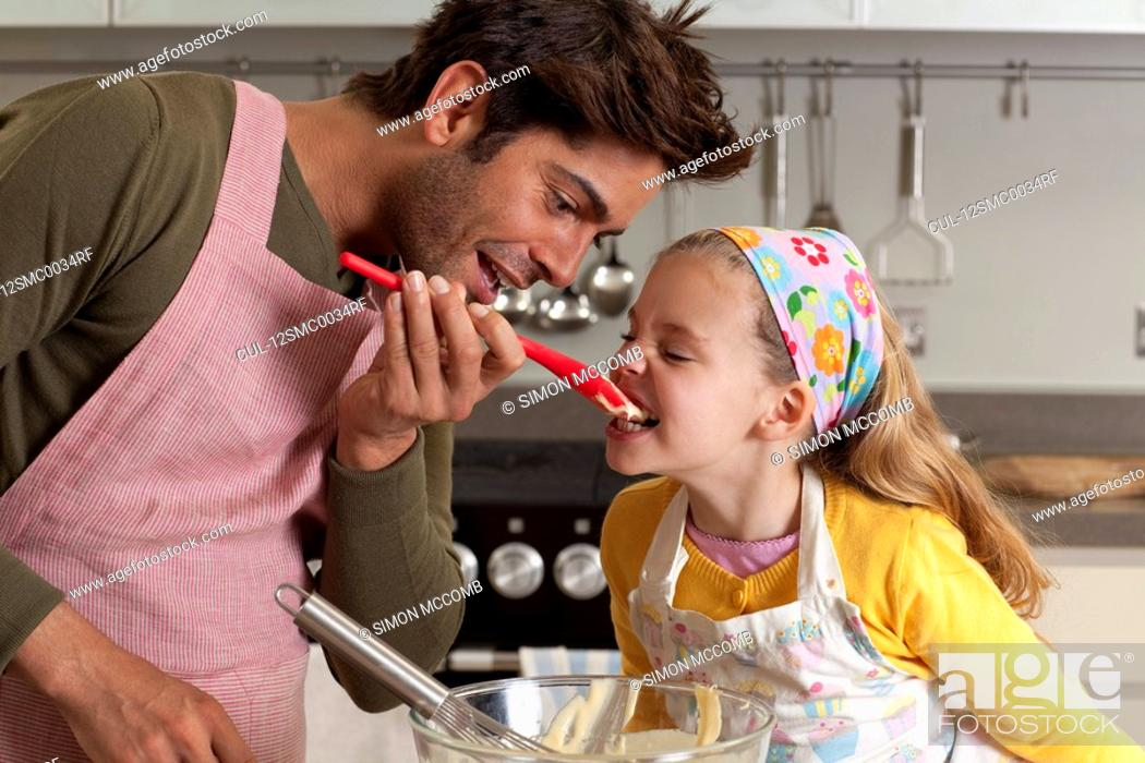 Stock Photo: father and daughter cooking.