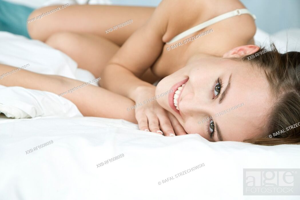 Stock Photo: woman in underwear lying in bed.