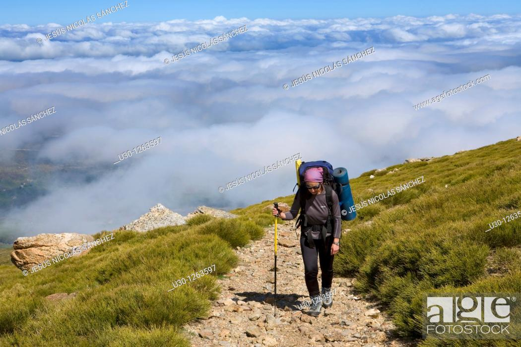 Stock Photo: Woman practicing mountaineering in the Sierra de Béjar Natural Park, in Salamanca province, Biosphere Reserve of Sierra de Béjar and Francia.
