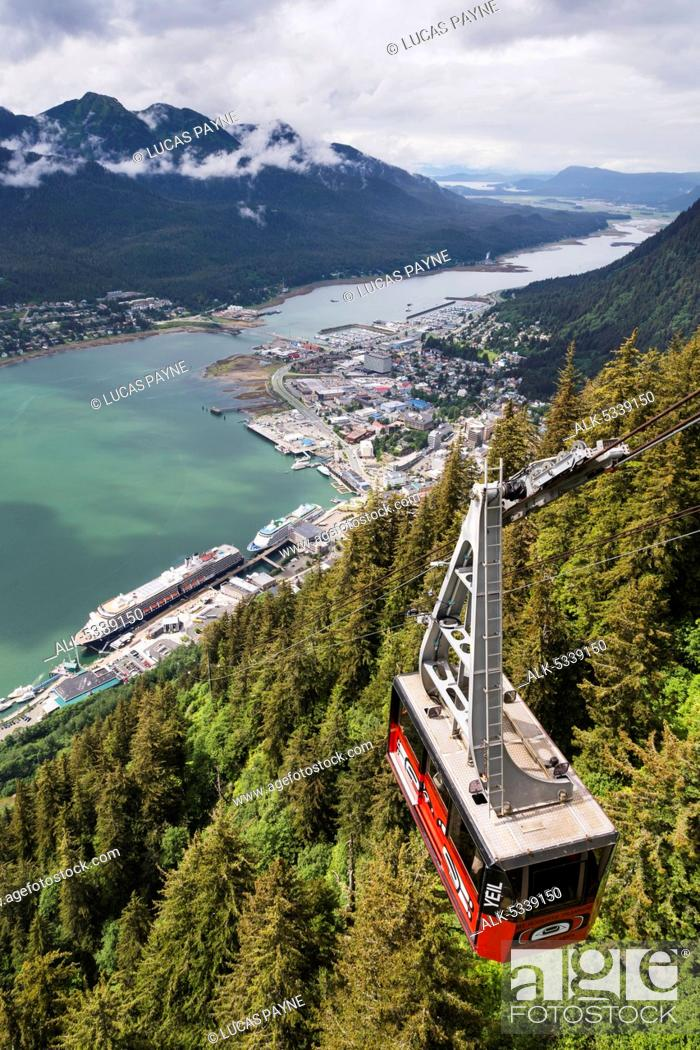 Stock Photo: View of the Mount Roberts Tramway above Juneau and cruise ships in Gastineau Channel, Southeast Alaska, Summer.