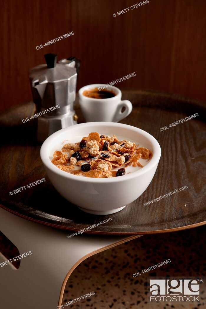 Stock Photo: Bowl of granola with cup of coffee.