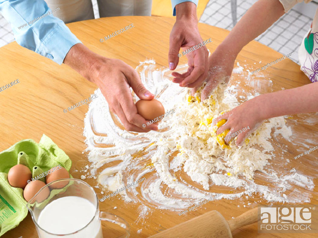 Stock Photo: Woman and girl mixing ingredients.