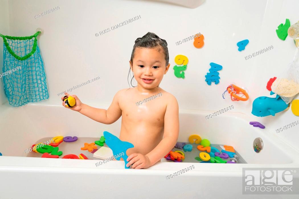 Stock Photo: Little boy in bath tub at bath time.