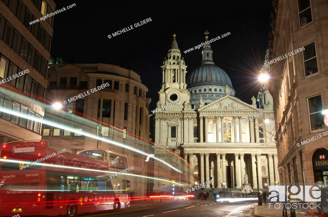 Stock Photo: St  Paul's Cathedral at night, showing the West Entrance from St Paul's Church Yard, with motion blur traffic lights, London, UK.