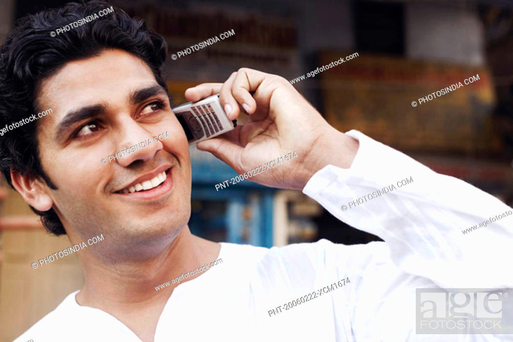 Stock Photo: Close-up of a young man talking on a mobile phone.