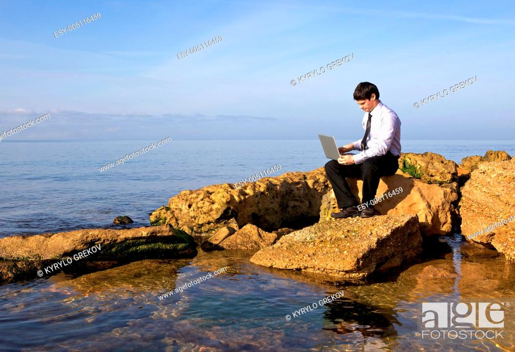 Stock Photo: Man with laptop.
