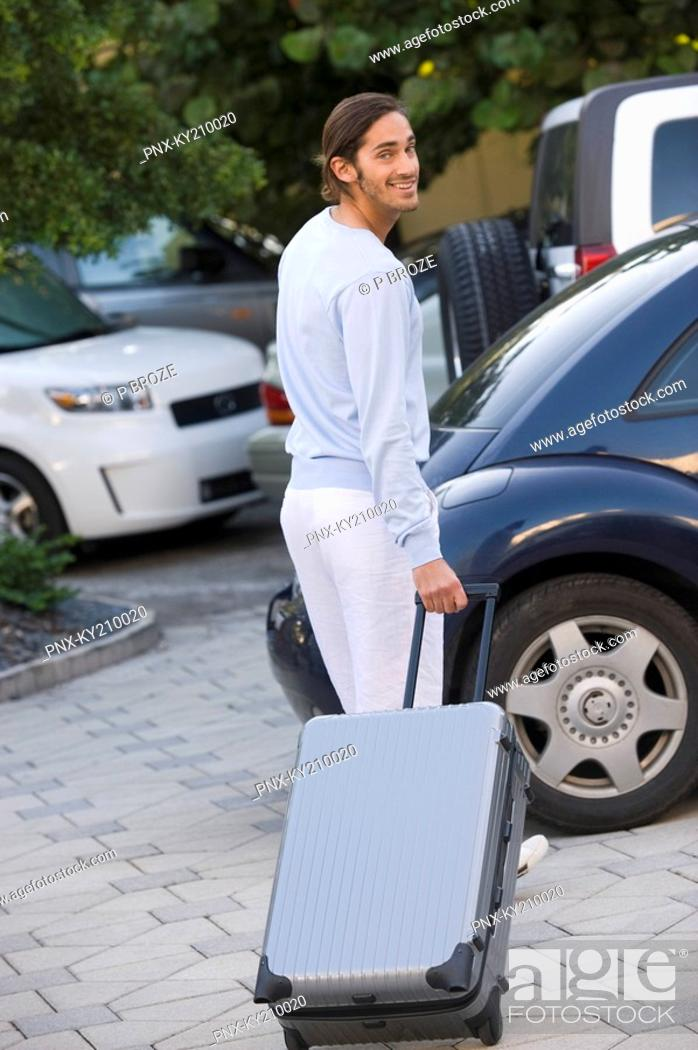 Stock Photo: Man standing with luggage.