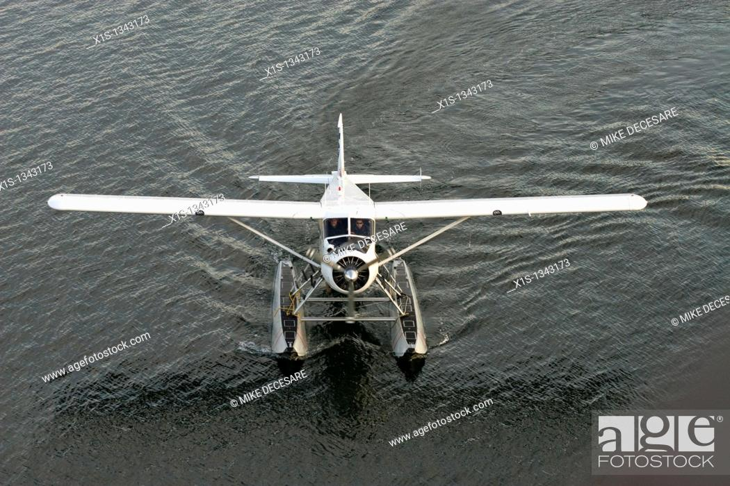 Stock Photo: A single engine float plane taxis in Vancouver marine.