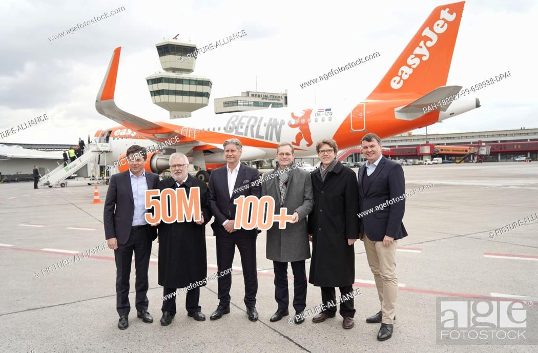 Stock Photo: 27 March 2018, Germany, Berlin: Thomas Haagensen (left to right), German head of the Easyjet budget airline, Rainer Bretschneider.