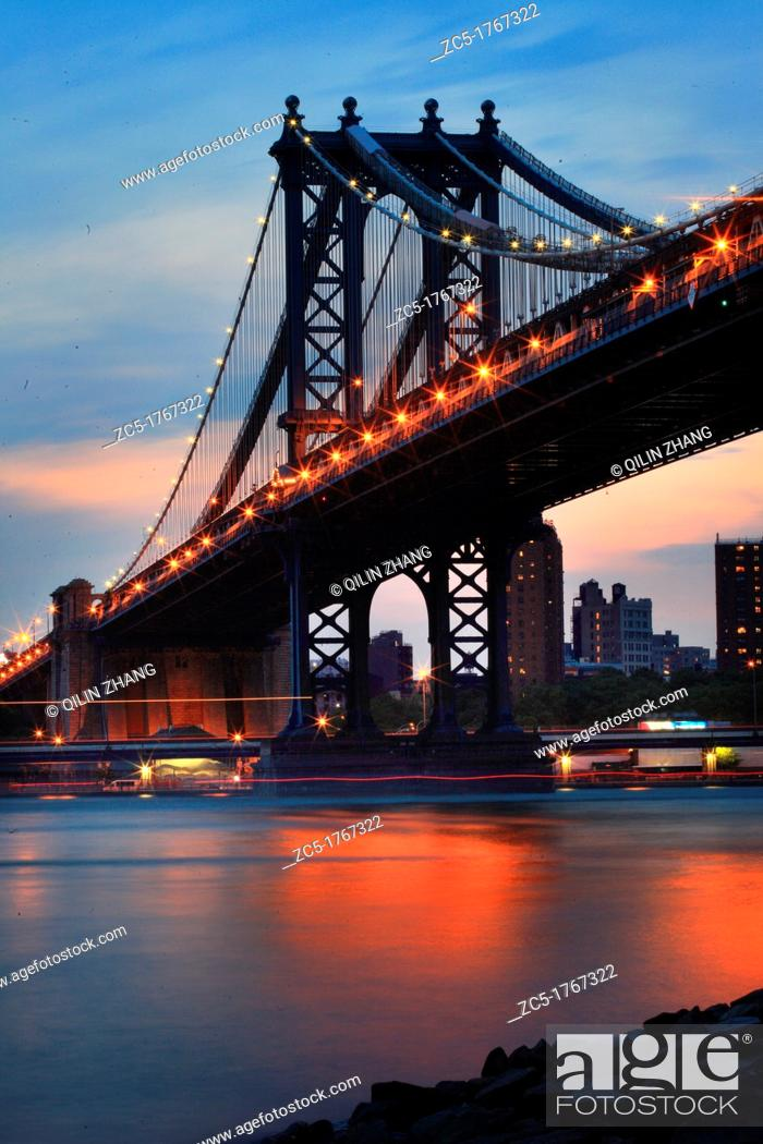 Stock Photo: USA, New York, Manhattan Bridge at dusk, view from Brooklyn, East River and Manhattan Skyline.