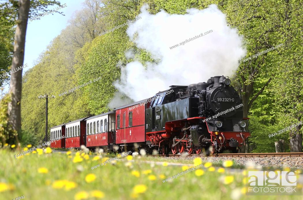 """Stock Photo: 19 April 2020, Mecklenburg-Western Pomerania, Rostock: View of the """"""""Molli"""""""" bathing area. The steam-driven narrow-gauge railway connects the towns Kühlungsborn."""