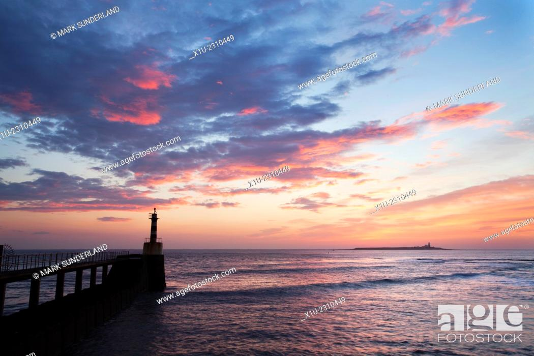 Stock Photo: Harbour Light and Coquet Island at Dawn Amble by the Sea Northumberland England.