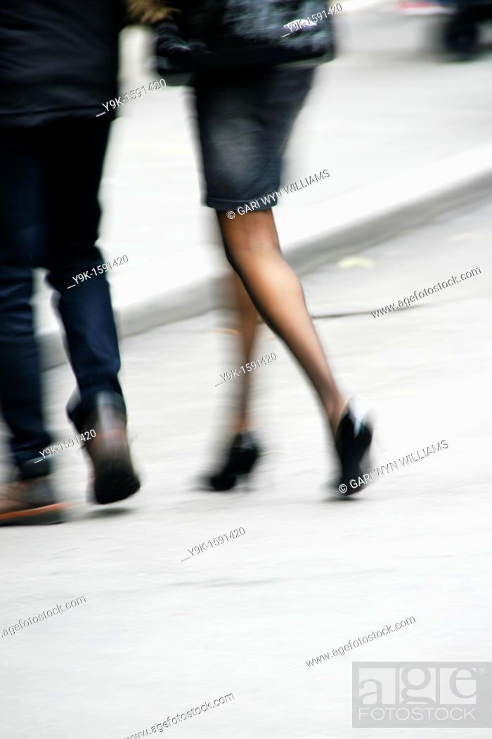 Stock Photo: Couple walking in street in city town.