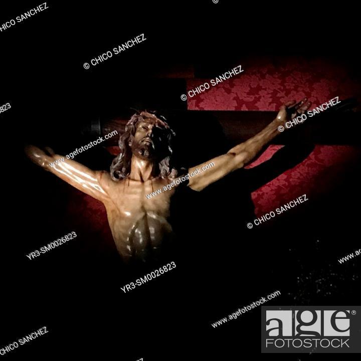 Stock Photo: An image of Jesus Christ crucified is displayed at night during Semana Santa in Prado del Rey, Sierra de Cadiz, Andalucia, Spain.