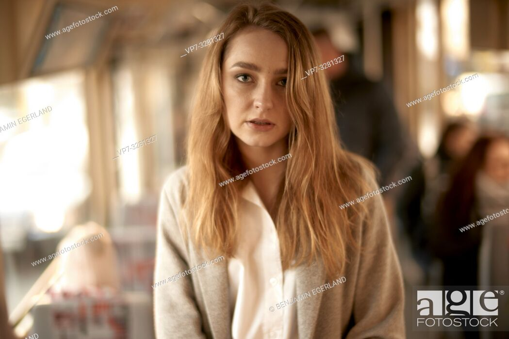 Stock Photo: young woman inside public transport, train, in Cottbus, Brandenburg, Germany.