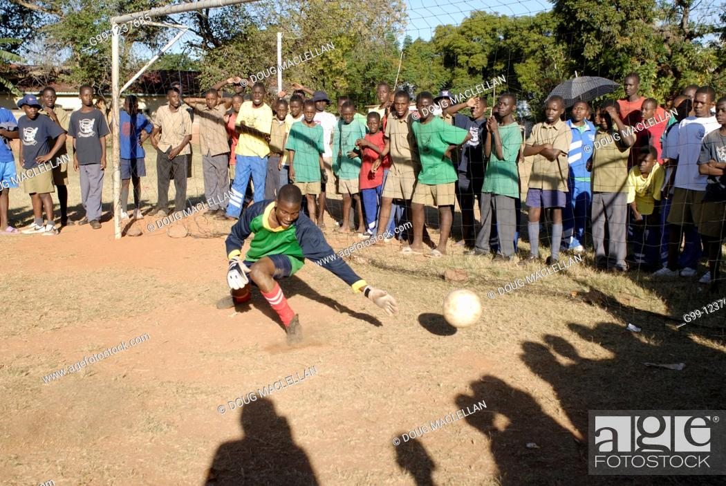 Stock Photo: Zimbabwe, Mashonaland Central, Howard Institute. May 2010. Africa Day sports events at a boarding school. Goalie made the save this time.