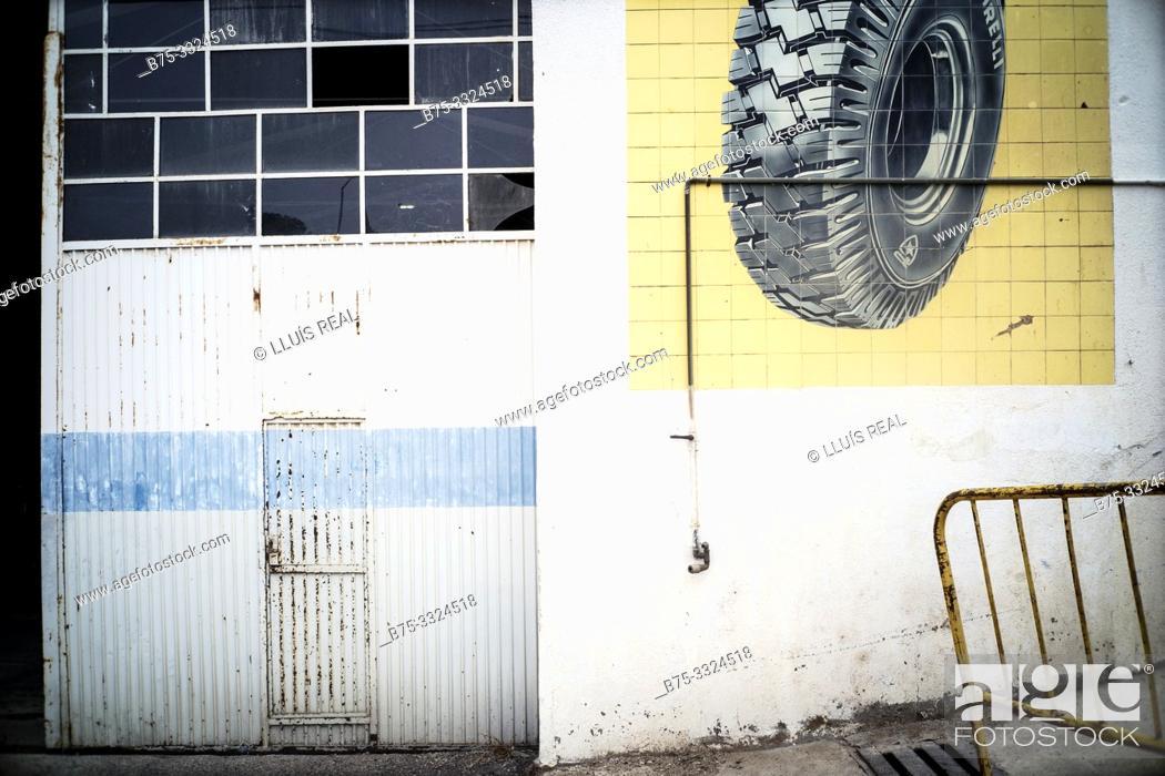 Stock Photo: Partial view of the facade of a workshop. Falset, Tarragona, Catalonia, Spain, Europe.