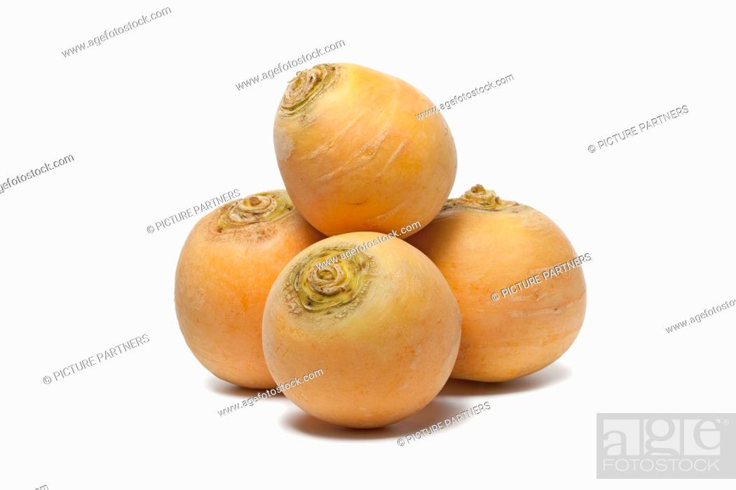 Stock Photo: Yellow turnips on white background.