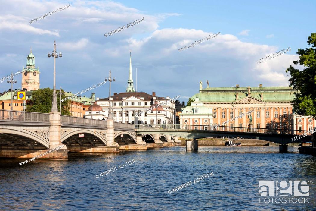 Stock Photo: Railway bridge with church in the background, Storkyrkan, Gamla Stan, Stockholm, Sweden.