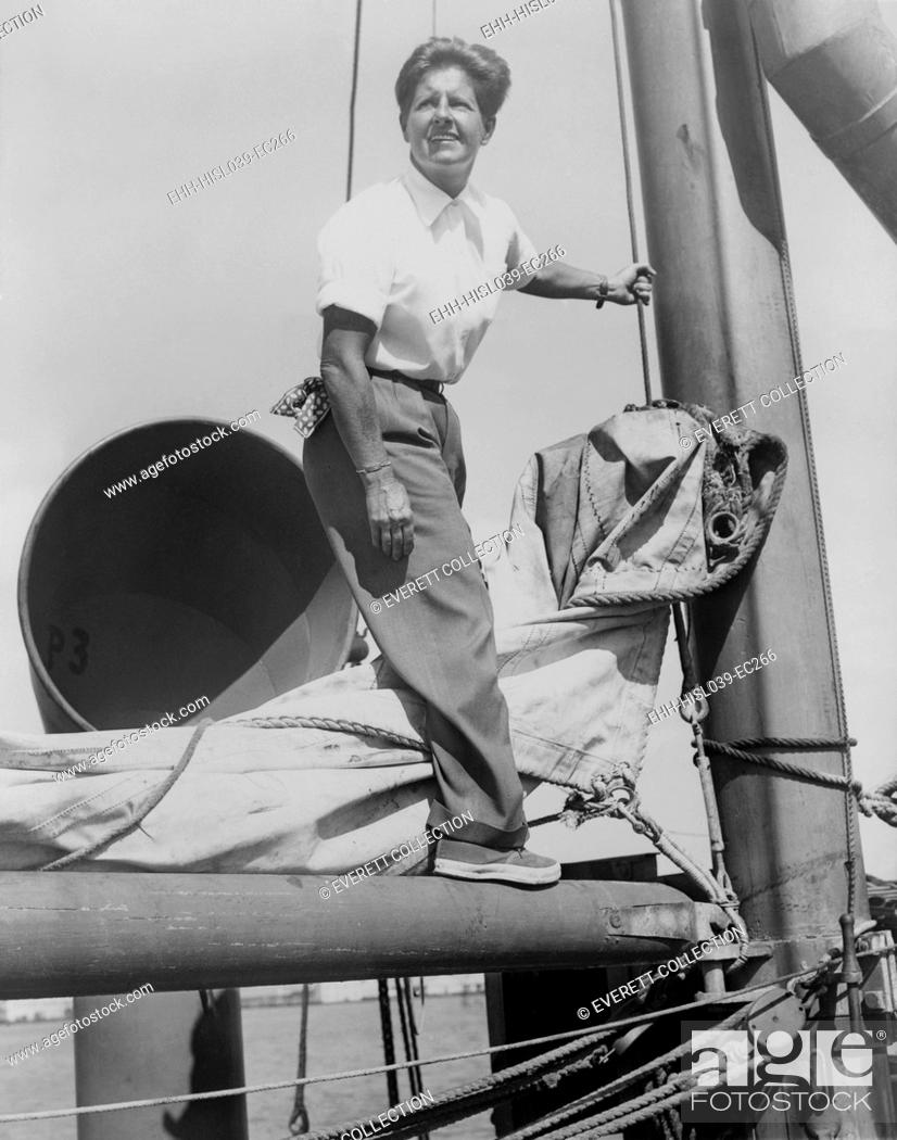 Stock Photo: Joe Carstairs on the rigging of her yacht Sonia 2 in 1944. Marion Barbara 'Joe' Carstairs was openly lesbian, wore men's clothes, tattooed her arms.