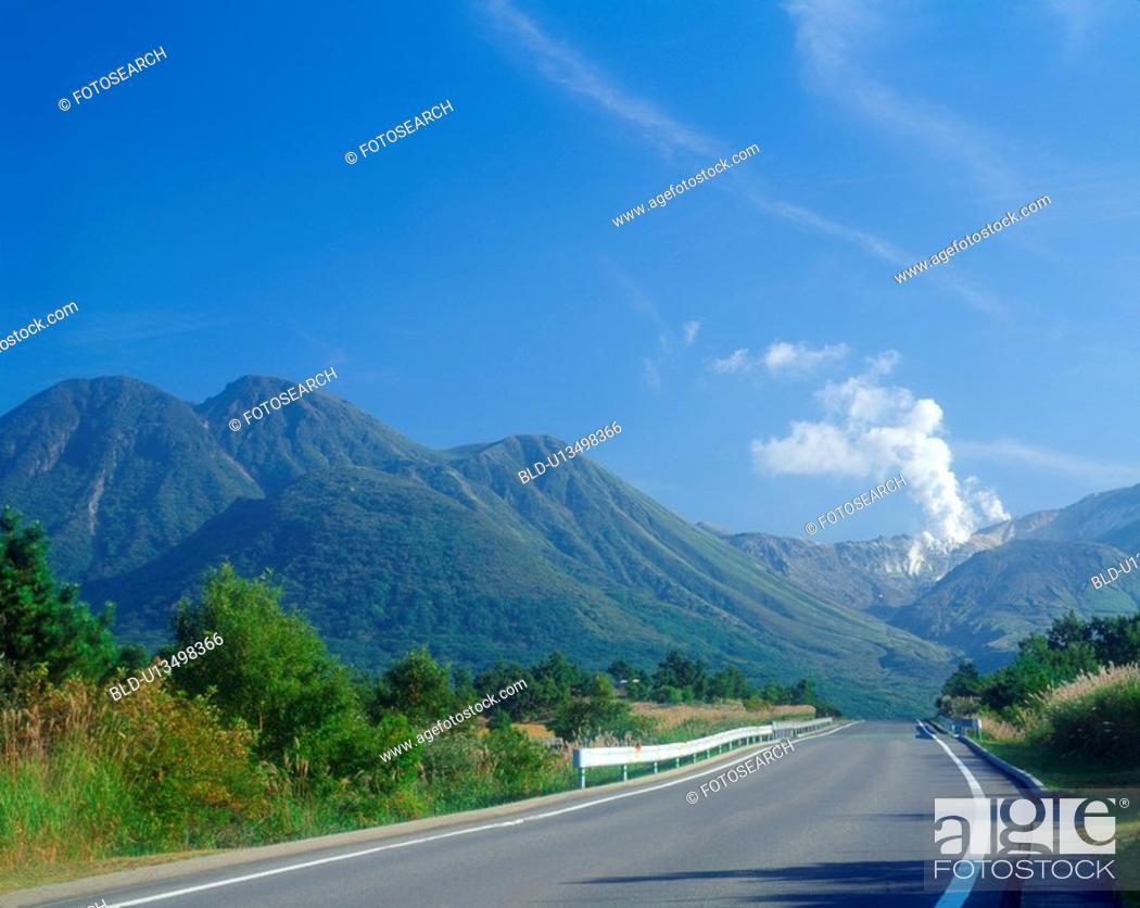 Stock Photo: Road that leads to mountain.