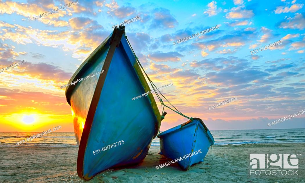 Stock Photo: Fishing boats and sunrise on Black Sea beach.