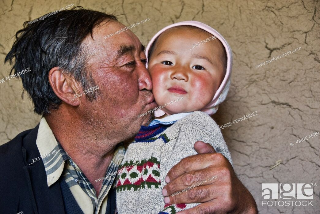 Stock Photo: Old man with grandson at home  Kyrgyzstan.