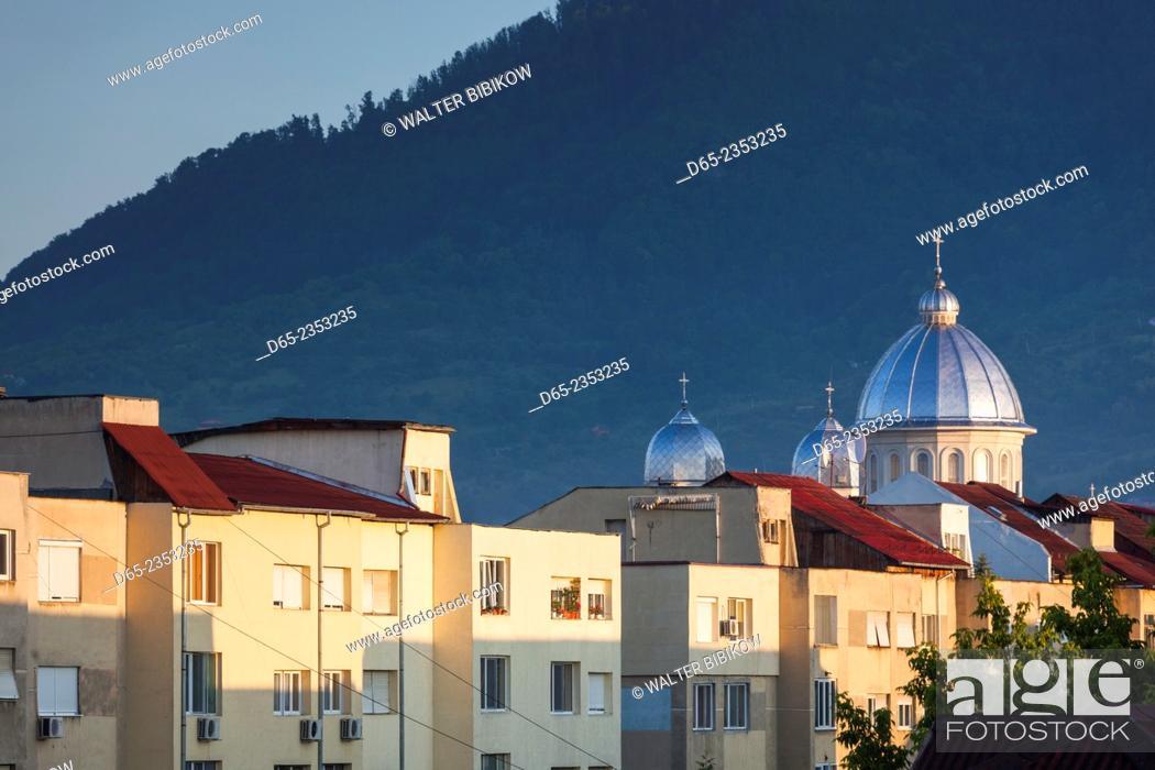 Stock Photo: Romania, Maramures Region, Baia Mare, buildings along Republicii Boulevard and Nasterea Domnului Orthodox Church, dawn.