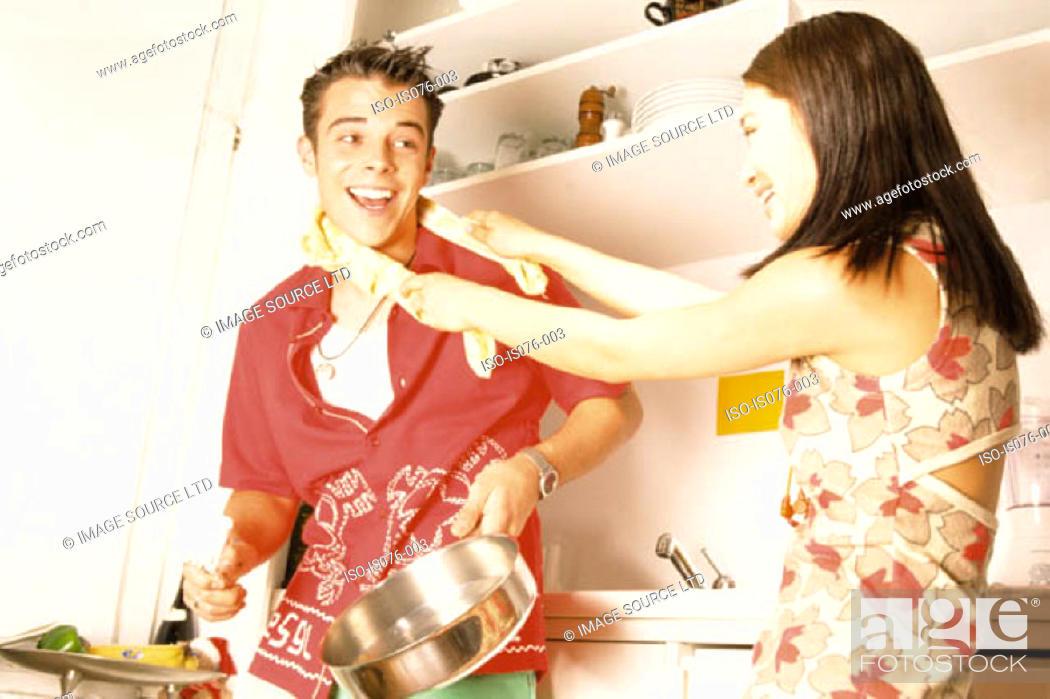 Stock Photo: Couple in kitchen.