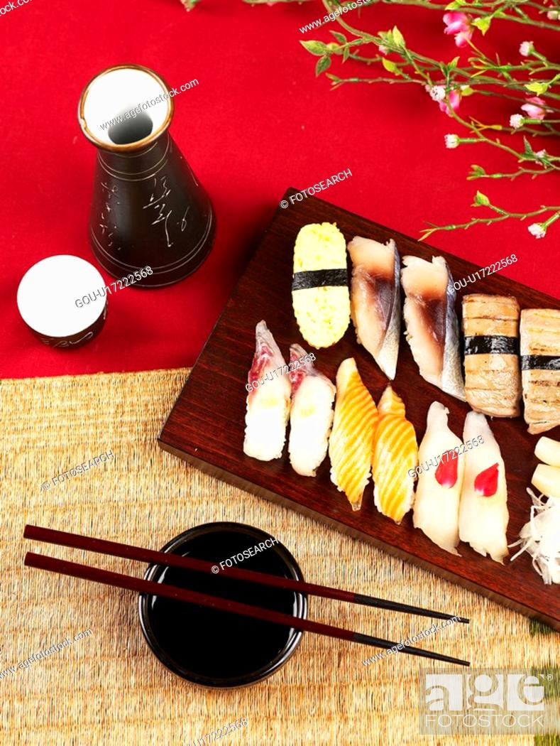 Photo de stock: soy sauce, plate, chopsticks, decoration, food styling, sake bottle, sushi plate.