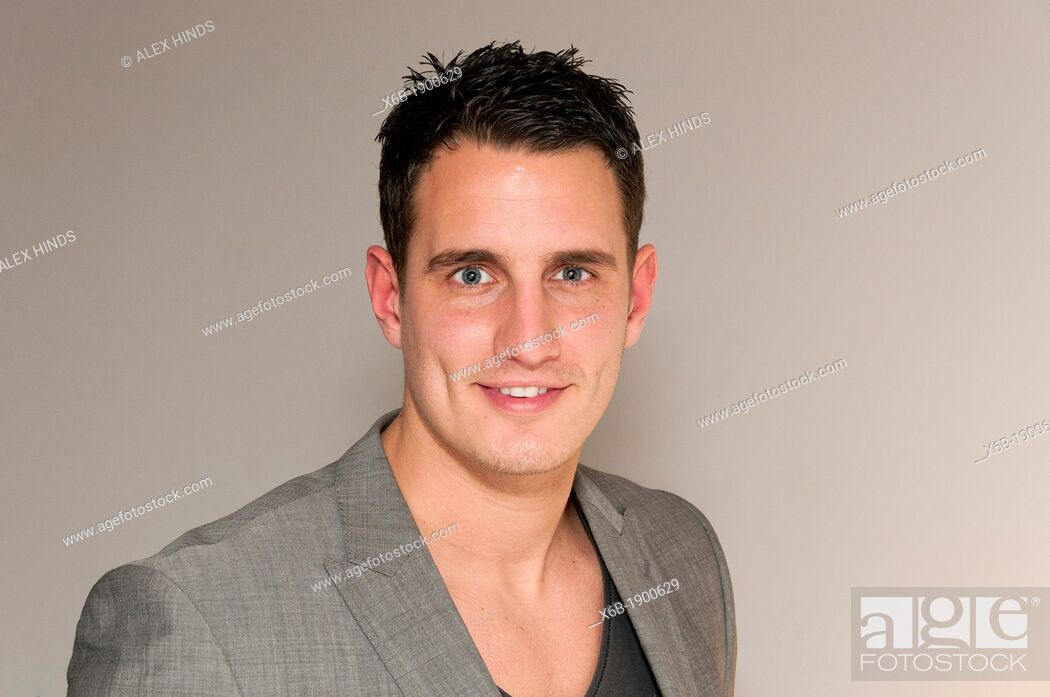 Stock Photo: Handsome young man in smart casual clothing.