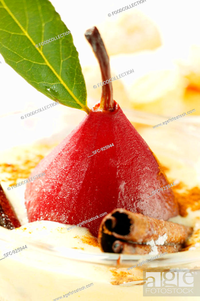 Stock Photo: Pear in red wine with cinnamon in Madeira cream.