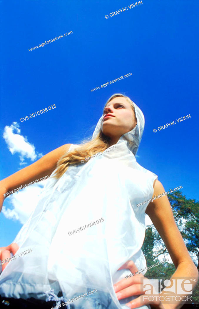 Stock Photo: Woman standing with hands on her waist.