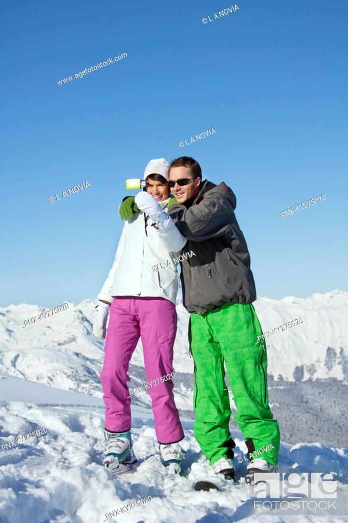 Stock Photo: Young couple in ski wear taking self portrait.