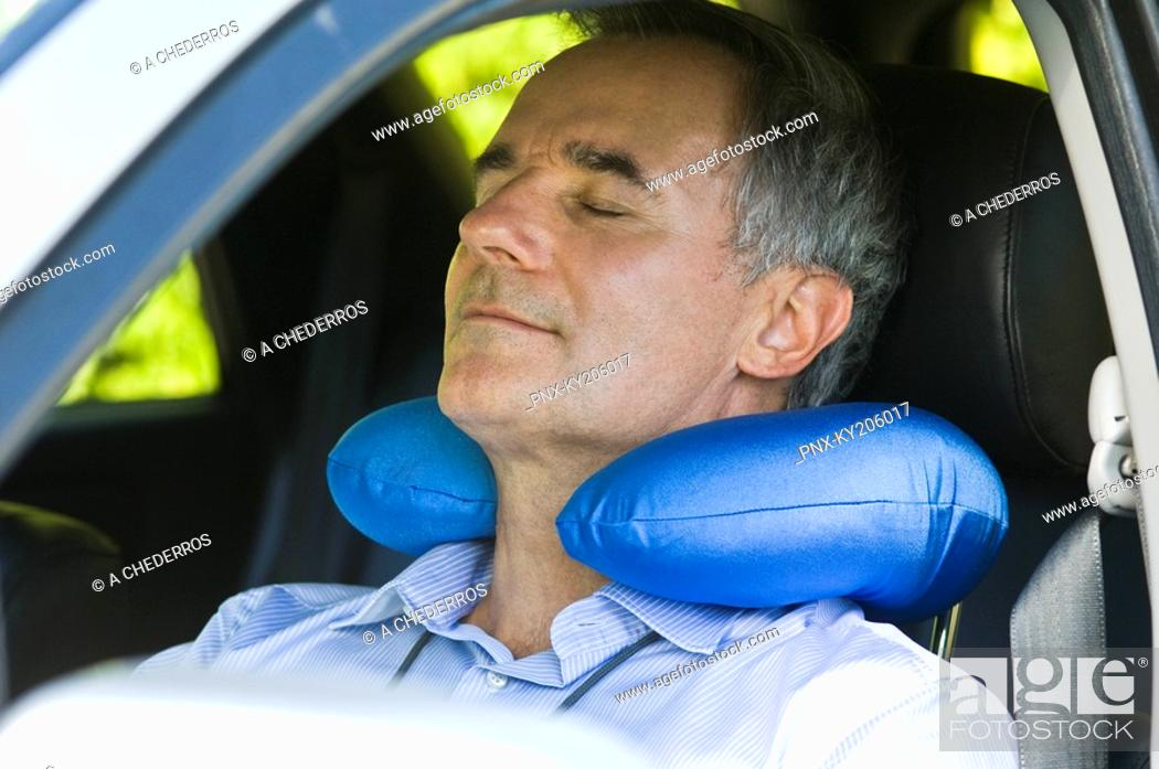 Stock Photo: Man sleeping in a car.