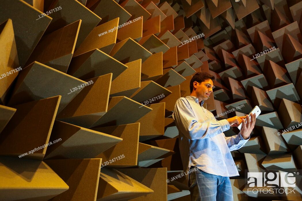 Stock Photo: Researcher. Acoustic chamber. EMC & Telecom Lab. Certification of Low Voltage Electrical & Electronic Products. Technological Services to Industry.