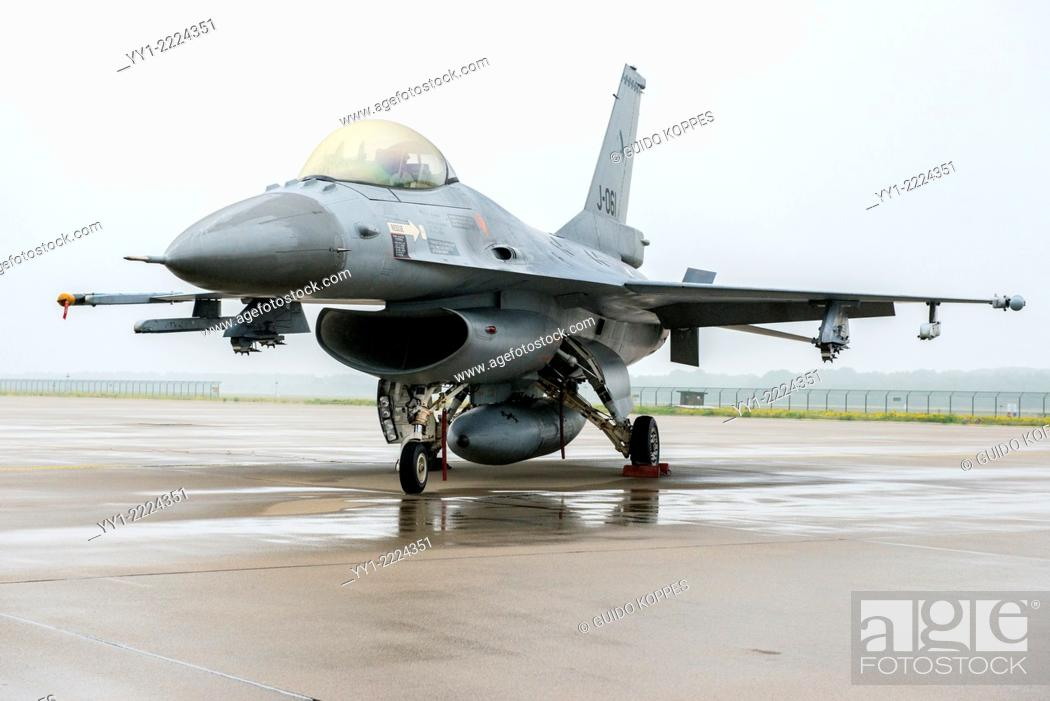 Stock Photo: Eindhoven Airbase, Netherlands. Dutch Fighting Falcon F-16 fighter jet parked on the platform of Eindhoven Airforce base.