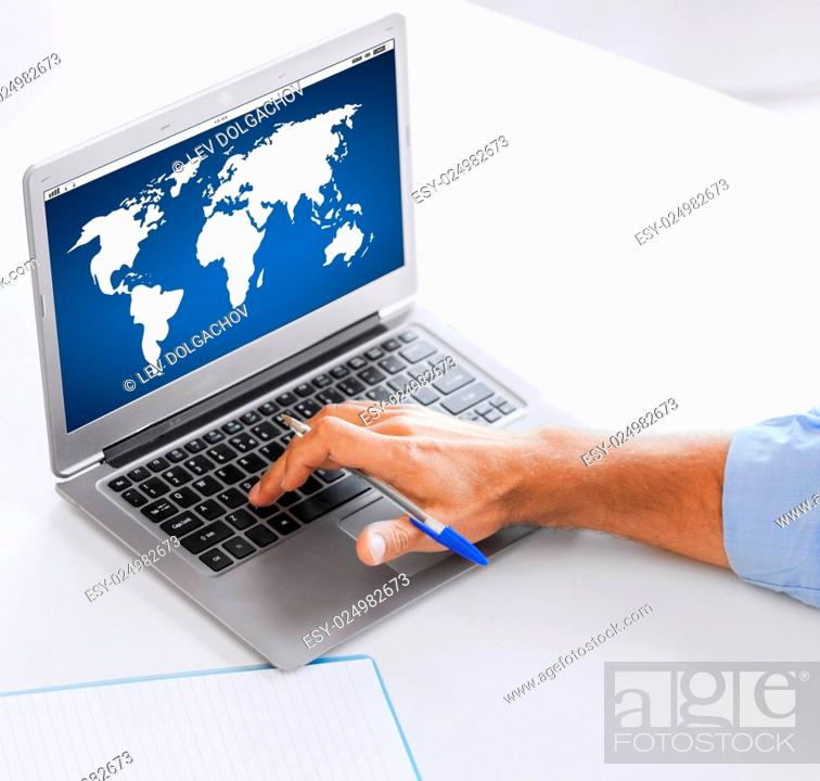 Stock Photo: business, technology, global communication, network and people concept - close up of businessman with world map on laptop computer screen working at office.