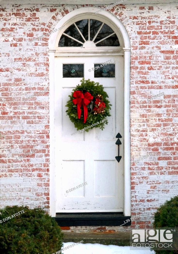 Stock Photo: Christmas decorations on door. Amherst, Massachusetts. USA.