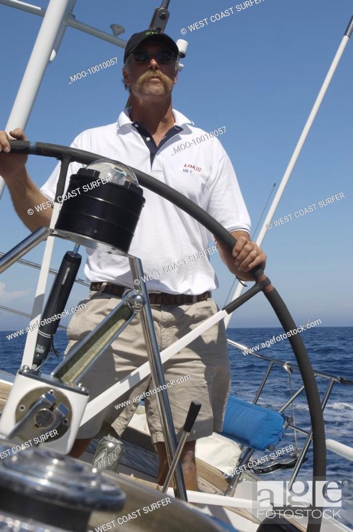 Stock Photo: Man Steering Yacht.