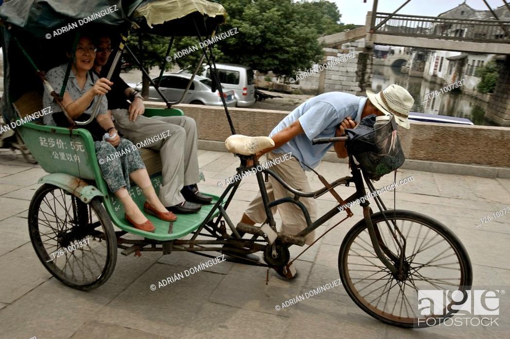 Stock Photo: Tong Li taxi. China.