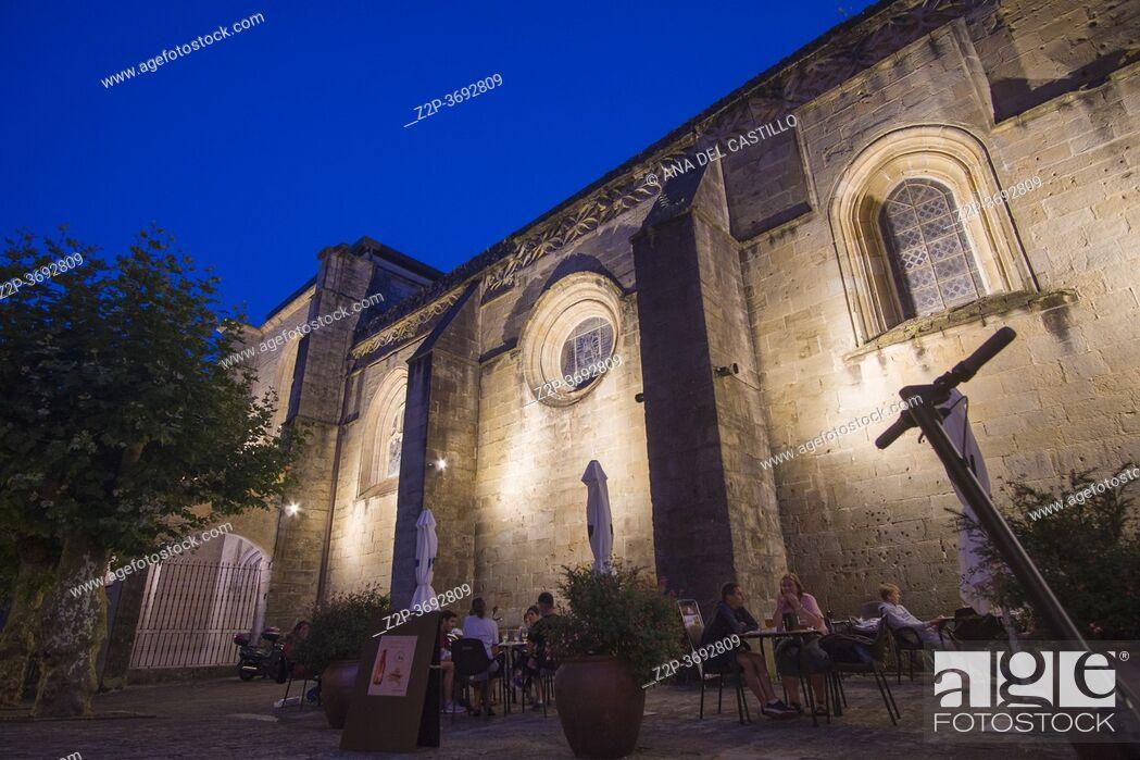 Stock Photo: Hondarribia, a town in Gipuzkoa, Spain on July 23, 2020: The medieval city by dusk. Asuncion church.