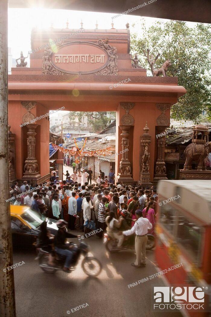 Stock Photo: Crowd at the entrance of a temple during religious procession of Ganpati visarjan ceremony, Mumbai, Maharashtra, India.